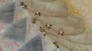 Here's a closeup of the beading, just so ya know...