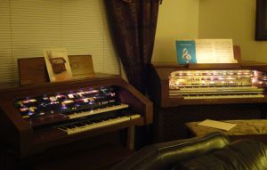 Mom's Lowrey Organ on the right, John's on the left...