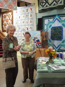 Joyce (on the right) at the exhibit