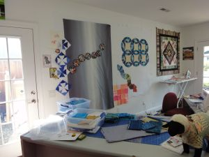 Taken from in front of the stash shelving, looking across my cutting table to the design wall