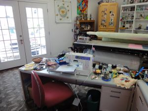 My sewing station, with a couple projects laying beside it (moved so I could clear the cutting area)