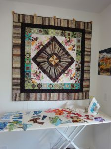 My ironing station, with a Round Robin quilt that Debby and I worked on together