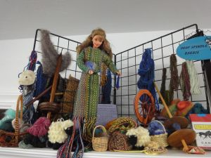 From my spinning & weaving days.  Her outfit is made from a horoscope warp -- each thread represents a color assigned for every horoscope degree - 360 threads